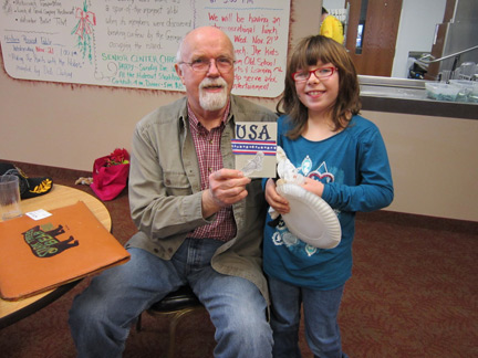 (Karla Wotruba/River News)Mike Baker and Mackennzie Yoder hold the card that Mackennzie made in honor of Veterans Day as an activity at Old School Arts & Learning Center. Baker, a volunteer meal delivery driver for the Oneida County Senior Center, received the card and wrote Mackennzie a letter thanking her for remembering veterans. The two met Nov. 21 and were able to thank each other in person.