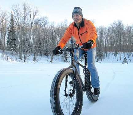 Bikes And Boards Rhinelander Wi rides a fat tire bike over