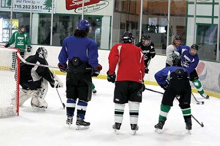 Members of the Rhinelander High School boys� hockey team hold a captains� practice Friday, Dec. 23 at the Rhinelander Ice Arena. The team cannot formally practice until Jan. 2 under a joint decision by the School District of Rhinelander and the Oneida Country Health Department who are trying to control an outbreak of pertussis, but a majority of team members showed up for a voluntary practices that were held without RHS coaches in attendance. (BoB Mainhardt for the River News)