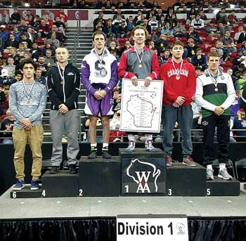 Rhinelander�s Jacob DeMeyer, second from left, stands on the podium after placing fourth in the Division 1, 145-pound weight class in the WIAA state wrestling tournament Saturday, Feb. 25 at the Kohl Center in Madison. (Tom Handrick for the River News)