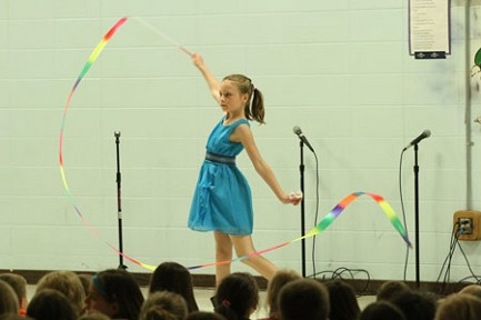 Third-grader Sophia Pearson demonstrates ribbon twirling.