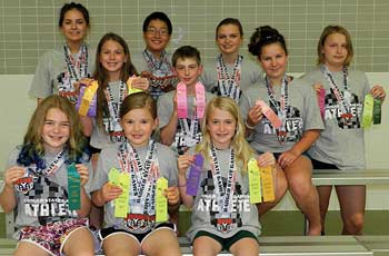 Ten members of the Rhinelander Swim Club competed recently in the Badger State Summer Games. Pictured in the front row, from left to right, are Ellyse Younker, Emma Houg and Vivian Lamers. In the second row are Abi Winnicki, Shawn Denis and Ella Cordy. In the back row are Makenna Winnicki, Jack Antonuk, Lisa Kennedy and Sage Schultz. (Submitted photo)