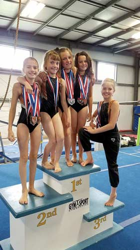 Pictured, from left, Seanna Stine of Iron River, Mich.; Jasmyn Joslin of Sugar Camp; Charlie Goehe of Conover; Alexis Joslin of Sugar Camp; and Lily Acklam of Minocqua pose after the Badger State Games on June 24 at Gym Sport Gymnastics in Schofield. (submitted photo)