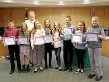 Contributed photographsWinners of the Land and Water speaking contest pose with their awards. Pictured, from left, with county conservationist Michele Saudauskas, are Eli Erickson, Ella Spears, Jenn Erikson, Kaya Szews, Samantha Gardner, Tobias Volkman, Kaylee Graves and Traeton Fogerty.