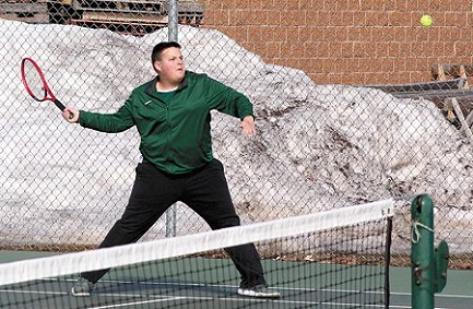 Rhinelander�s Logan Oestreich hits a return at No. 1 doubles during a Great Northern Conference boys� tennis match at Medford High School Tuesday, April 9. Oestreich and doubles partner Connor Young defeated Medford�s Riley Kleist and Luis Silva, 6-0, 6-2. The Hodags swept all three doubles matches in a 5-2 victory over the Raiders. (Brian Wilson/Star News)