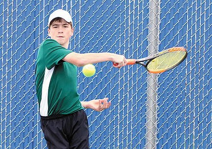 In this Friday, May 3 file photo, Jacob Weddle hits a return during a non-conference boys� tennis invite at Wausau West High School. Weddle, who entered play Friday with a 9-0 record in the Great Northern Conference at No. 1 singles, leads a Hodag squad that will look to wrap up its sixth straight GNC title today during the conference tournament in Minocqua. (Jeremy Mayo/River News)