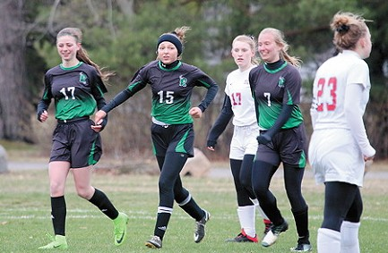 Rhinelander�s Payton Van Zile (15) is congratulated by teammates Jaden Olski (17) and Brooke Mork (7) after scoring a goal during a Great Northern Conference girls� soccer game against Wausau Newman at the RHS soccer fields Thursday, May 9. The Hodags got goals from seven different players in a 7-0 victory over the Cardinals. (Photos by Bob Mainhardt for the River News)