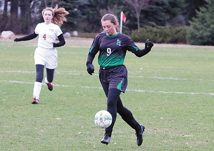 Rhinelander�s Emma Roberts possesses the ball during the first half of a Great Northern Conference soccer game against Wausau Newman at the RHS soccer fields Thursday, May 9.