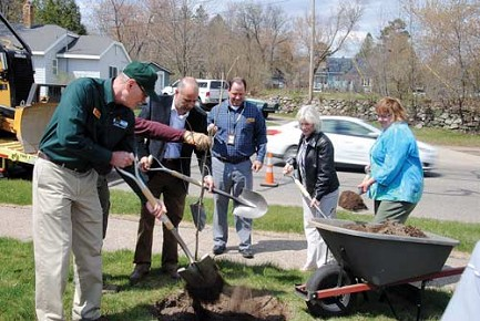 Jacob Friede/Lakeland TimesIn celebration of Arbor Day, chief DNR state forester Fred Souba, Chequamegon-Nicolet National Forest supervisor Paul Strong, DNR secretary�s director James Yach, State Senator Janet Bewley, and Jane Seivert of the Wisconsin County Forest Association, plant a swamp oak tree in front of the Wisconsin state forestry headquarters in Rhinelander.