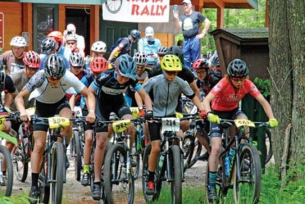Jacob friede/lakeland timesMountain bike racers take off from the start line at the sixth annual RASTA Rally held at Washburn Lake Silent Trails Area on Father�s Day.