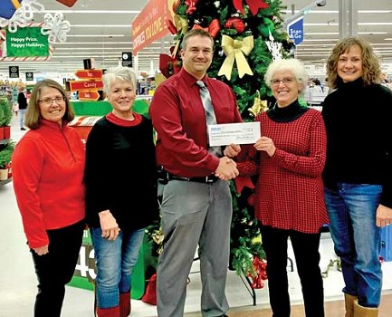 Submitted photoRhinelander Walmart manager Brent Sundby (center) presents a check from the Walmart Foundation to the four chairwomen of the Christmas Belles program, from left to right, Mary Bongratz, Corinne Duerkop, Barbara Benson and Ann Adamovich.