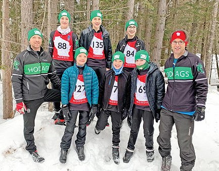 The Rhinelander middle school boys� Nordic ski team poses for a photo prior to a WNSL state meet race in Cable Sunday, Feb. 9. Pictured in the front row, from left to right are, coach Dave Slette, Olin Slette, Calvin Loomis, Carter Nelson and coach Shane Teter. In the back row are Ryan Morien, Charlie Loomis and Mason Shinners. (submitted photo)