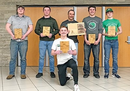 Rhinelander wrestling banquet award winners pose for a photograph following the team�s banquet Sunday, March 8 in the RHS commons. Kneeling is team MVP Tim Fox. Standing, from left to right are JV captain David Schramke, Mini-Machine Award winner Trevor Knapp, Hodag Wrestling Hall of Fame inductee Jim Kreitlow, Hodag Award winner Walker Hartman and most improved wrestler Cole Lehman.  (Submitted photo)